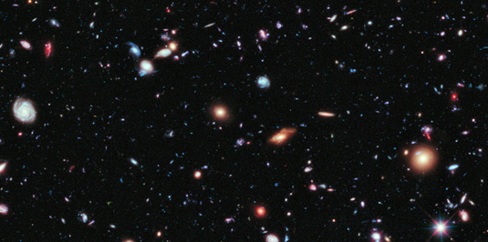 This image shows a tiny patch of our expanding Universe. But how did the cosmos get started?  Source: NASA, ESA, G. Illingworth, D. Magee and P. Oesch (University of California, Santa Cruz), R. Bouwens (Leiden University) and the HUDF09 Team.