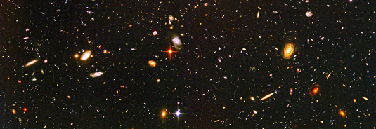 This image includes galaxies formed when the Universe was very young, in agreement with the quantum mechanical model for the origin of galaxies. How might the model be disproved? Foto: NASA/ESA/R. Windhorst (Arizona State University) / H. Yan (Spitzer Science Center, Caltech)
