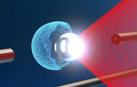 The Texas Petawatt laser pulse (red) is focused onto a levitating microsphere target. The immense laser-intensity causes the fierce explosion of the microsphere, thereby generating potentially useful energetic ions from an ultra-small source (blue). Picture: Tobias Ostermayr