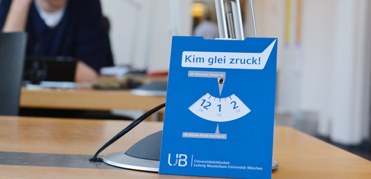 "The parking disks in the University Library bear the message ""Kim glei zruck"", informing newcomers when the previous occupant expects to return: ""I'll be right back"", i.e. by the time shown on the disk's clock-hand."