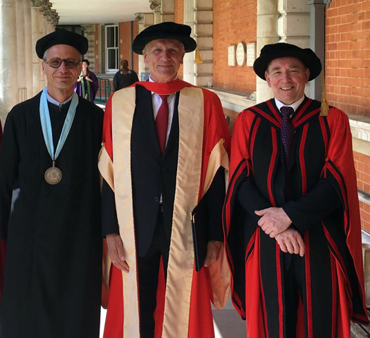Professor Wirsing in his doctoral gown, pictured with Professor José Fiadeiro (Head of Computer Science at Royal Holloway, on the left) and Professor Paul Hogg (Dean of the Science Faculty, on the right).