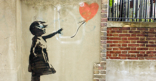 Girl with a heart-shaped balloon, depicted on a wall by the street artist Banksy. Capture: CAMERA PRESS/James Veysey/ddp images