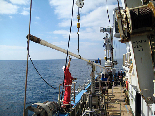 A 13 metre long sediment core is brought aboard the research vessel Pelagia. Image: Peter Clift, Louisiana State University, USA