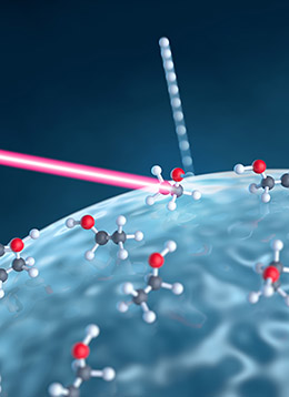 An intense laser pulse (red) hits a nanoparticle made of glass and interacts with molecules on its surface. Subsequently, as depicted, hydrogen ions may be detached, and the yield of such reactions can be measured by reaction nanoscopy. (Picture: Alexander Gelin)