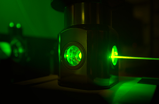 In green light: Experiment in Henry Dube's lab.